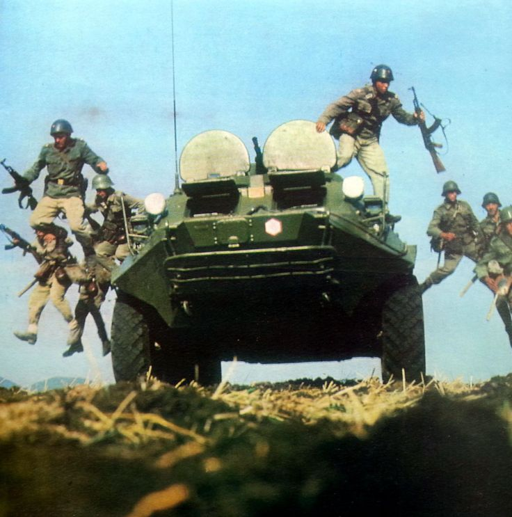 Bulgarian soldiers dismount from a BTR-60.