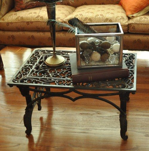 Metal door mat & sewing machine base transfomed into coffee table.
