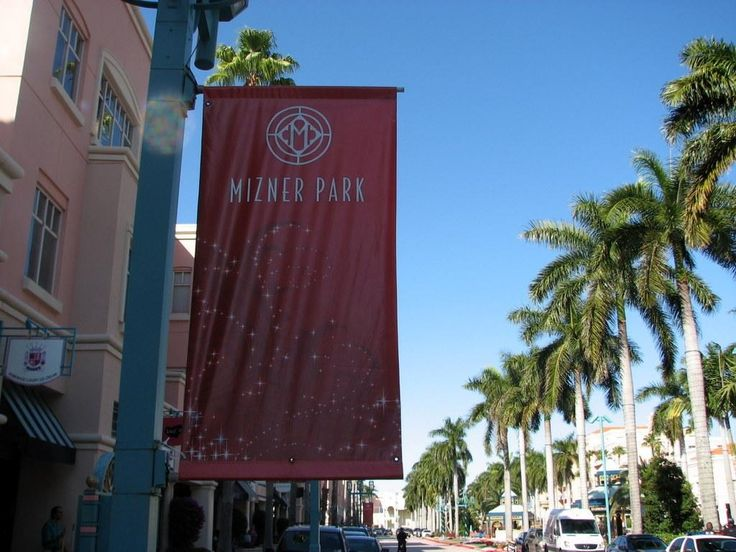 """Mizner Park is a three block long self-styled """" lifestyle """" center incorporating an upscale shopping mall, multiple dining establishments, rental apartments and commercial offices, and a cultural center as well as a multiplex cinema. The architectural style is Mediterranean with a wide median down the main thoroughfare with walkways, palm trees, gazebos, and fountains. Constructed in the late 1980's and early 1990's, it replaced a failed conventional enclosed mall."""
