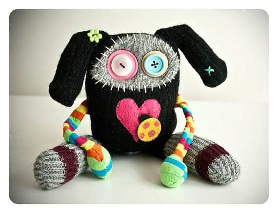 The Lady Bug Love Creature by rawrisiloveyou on Etsy.  Made with found materials.
