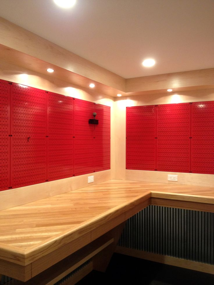 A REALLY nice workbench with red metal pegboard panels from Wall Control.