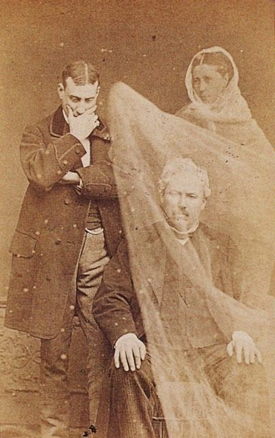 Ghost Photography - I like that there is a sheet which the ghost is holding up, covering the man this would probably work well using cling film for the fabric effect over a portrait.