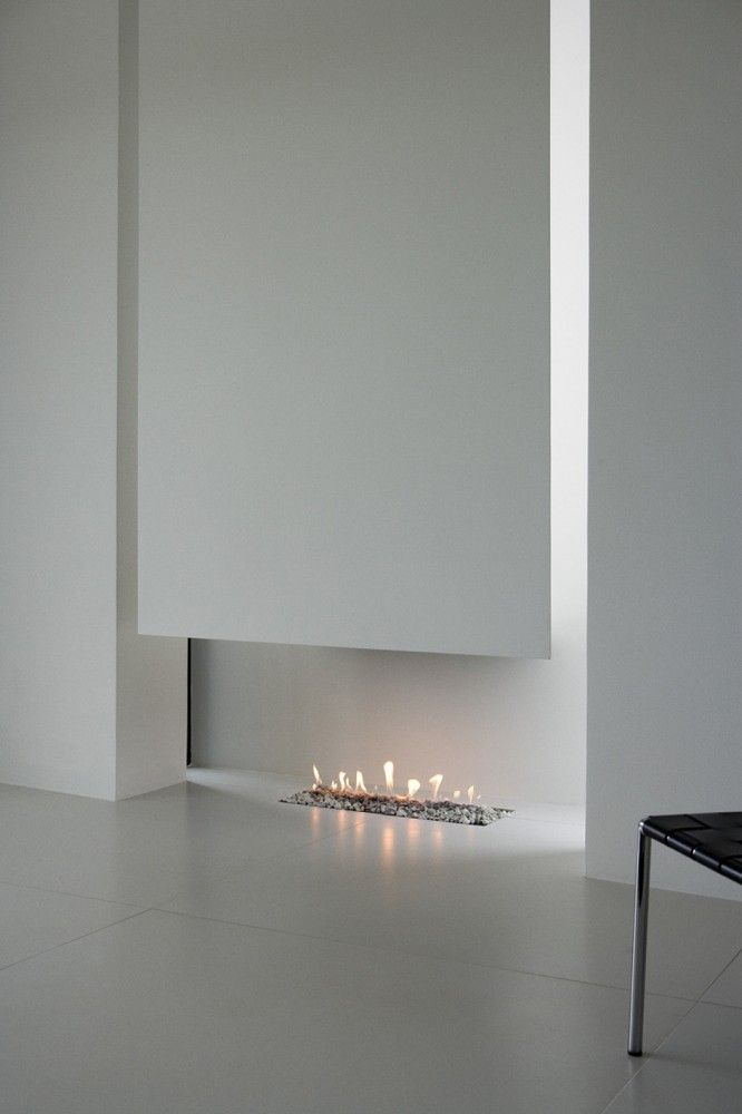 Minimal hearth inside the B25 House by PK Arkitektar | White & Natural | Kitchen & Living | Modern Minimalist Interiors | Contemporary Decor Design #inspiration #nakedstyle