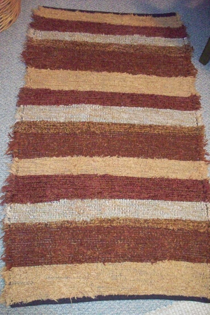 Handwoven Area Rug 29 X 51. This rug is woven in my Michigan studio. It is made of upholstery fabric selvedges from the furniture mills down south. This rug is several burnt oranges, gold and beige. Machine wash and dry. They are quite thick, may not work in front of a door. Great for any floor, wood, tile, or on carpet. Great for living room, den, kitchen, bath. They feel wonderful under your feet. May require a non-slip pad on some floors which are can be inexpensively purchased at Home...