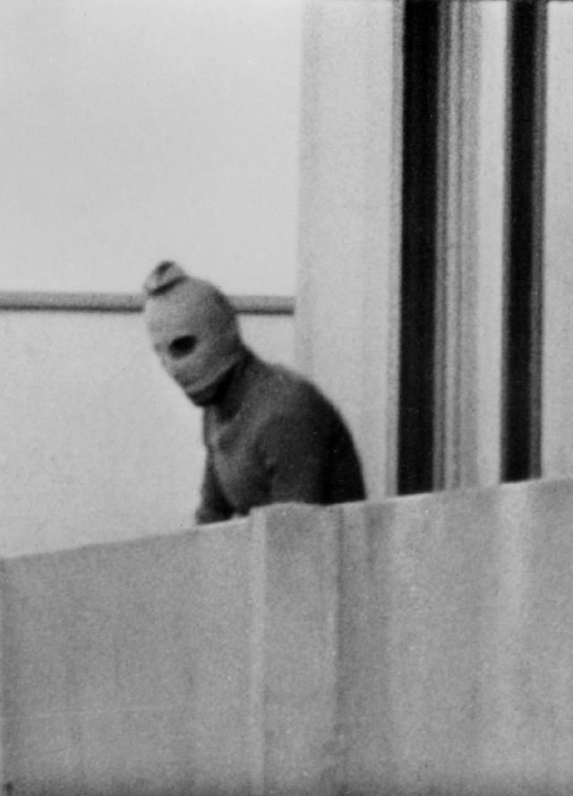 What Happened During the Munich Massacre?: One of the eight Palestinian terrorists comprising the Black September group stands on a balcony of the Olympic Village during a standoff after they kidnapped nine members of the Israeli Olympic team and killed two others on Sept. 5, 1972 in Munich.