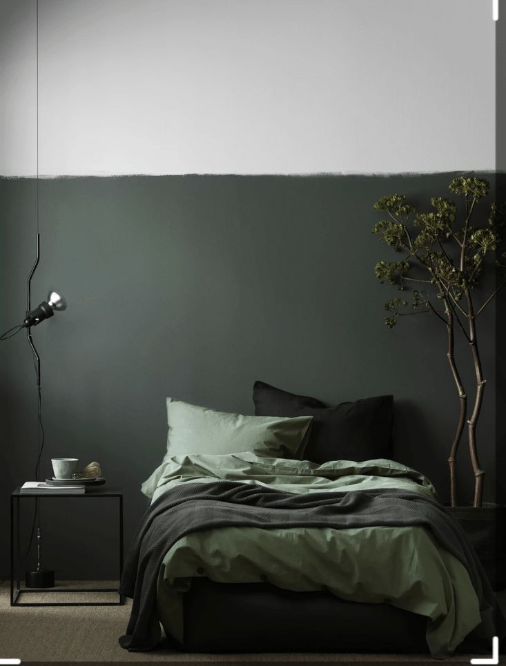 The monochrome bedroom: deep green bedroom by Swedish interior stylist Pella Hedeby for Elle Decoration Se. Photograph by Ragnar Omarsson.