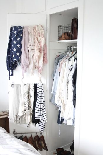 pretty closet using kitchen rods and s hooks from ikea