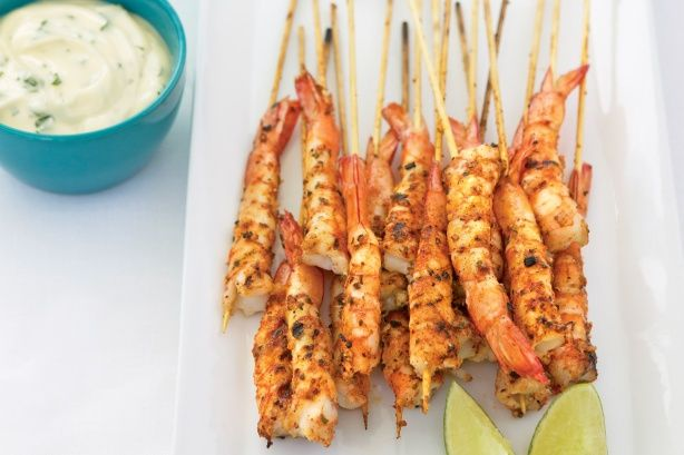 Infuse mayo with the fresh flavours of Asian herbs, then see how quickly these seasoned prawn skewers disappear.