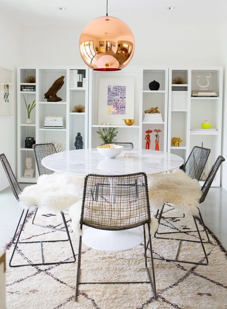 TOM DIXON'S COPPER PENDANT: how fabulous is this #modern dining room with wire chairs + Tulip #table?