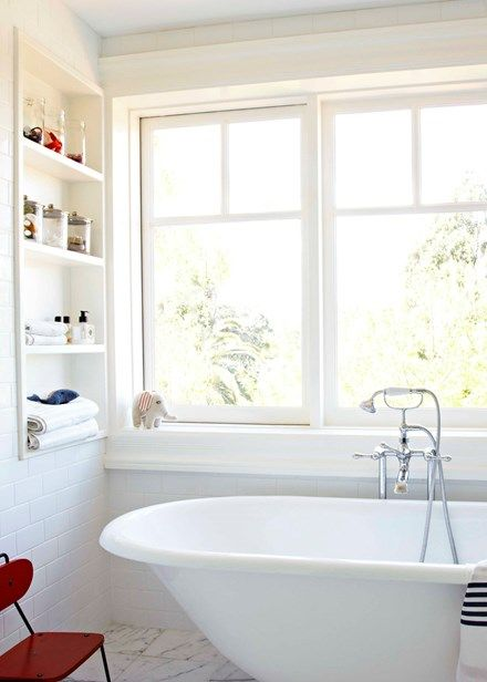 Clean lines and a statement bath give this bathroom wow factor - Home Beautiful