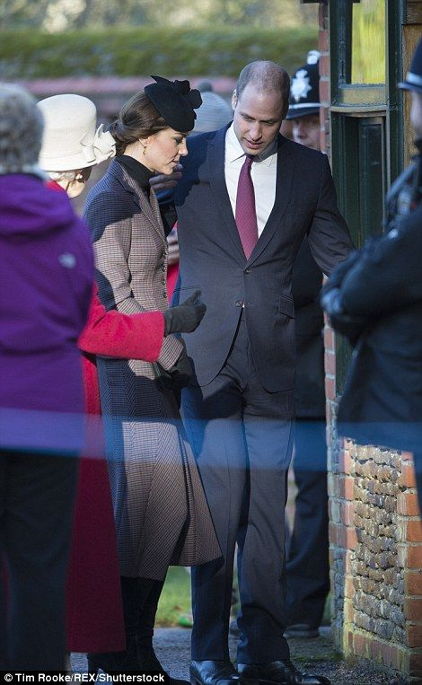 Prince William proves to be ever the gentleman as he holds the door open for his wife and lets her pass before him
