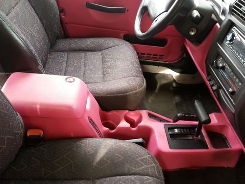 Black pink Jeep.. black interior with a splash of pink
