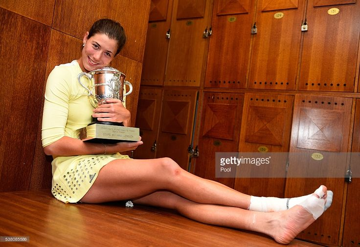 Garbine Muguruza of Spain poses with the trophy following her victory during the Ladies Singles final match against Serena Williams of the United States on day fourteen of the 2016 French Open at Roland Garros on June 4, 2016 in Paris, France.