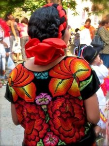 Huipil de Oaxaca. Huipil ['wipil] (from the Nahuatl word huīpīlli) is the most common traditional garment worn by indigenous women from central Mexico to Central America.