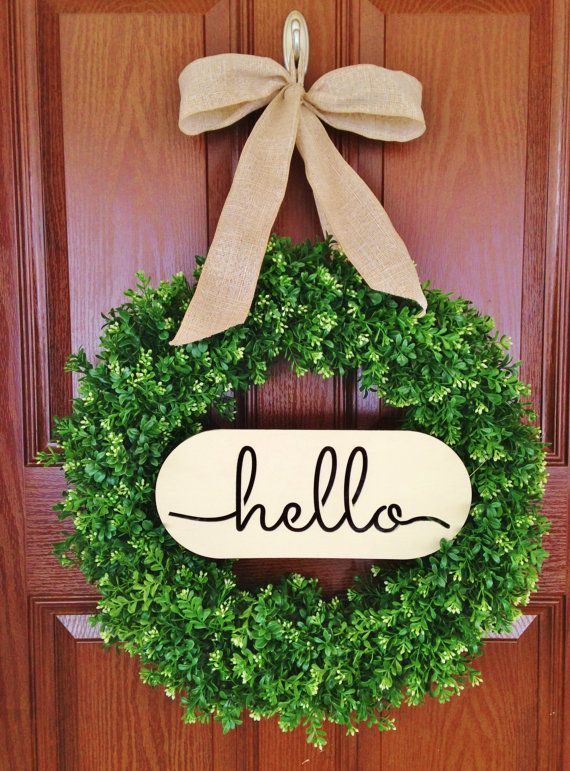 This is the most pinned Hello wreath on Pintrest right now!!  Welcome Boxwood Wreath, Hello Boxwood Wreath, Artificial Boxwood Wreath, House Warming Boxwood Wreath  Realistic-looking Boxwood Wreath made with varying shapes, sizes, and shades of leaves. The artificial boxwood branches provides more of a natural look. Each fade-resistant branch is tightly wired to a grapevine wreath base for extra support against the elements. I have personally tested these wreaths in some of the worst weather…