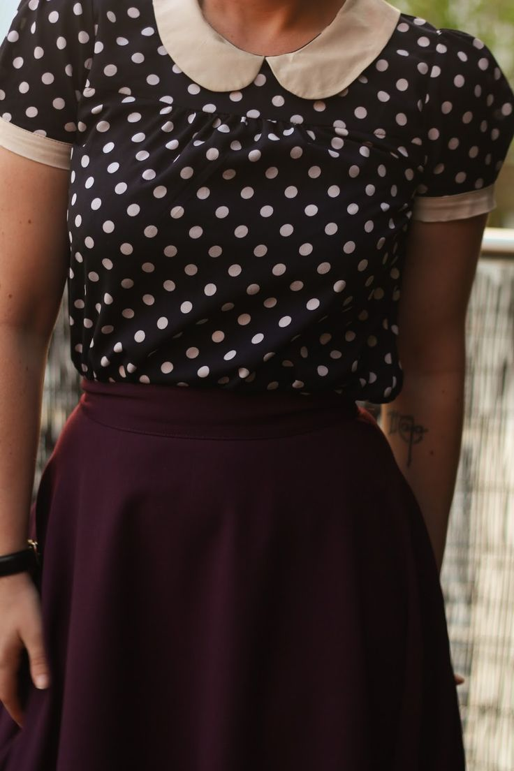 Liana of Finding Femme wears plum Modcloth midi skirt, wedge heel oxfords, and Modcloth navy polka dot peter pan collar blouse.