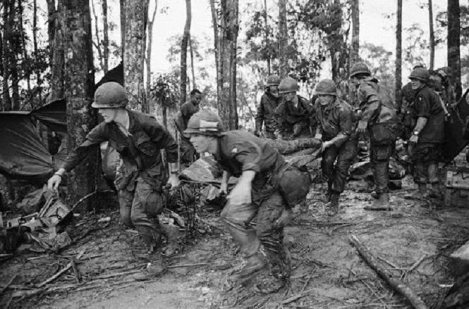 Soldiers carry a wounded comrade during the Battle of Hamburger Hill, Vietnam War.