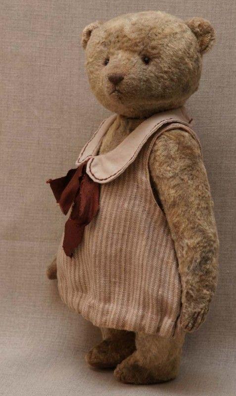 Teddy bear in striped dress by Hypatia.