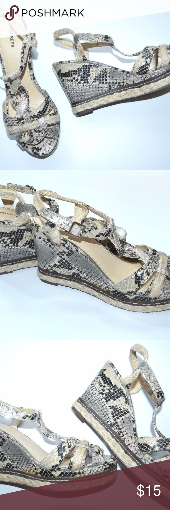 Express Womens 7 Wedge Snakeskin Sandals Shoes Express Womens Wedge Snakeskin Sandals Shoes Espadrille  Sz 7  Condition: VGUC, a little glue showing on the seam in a few places, just cosmetic, and not really noticeable unless looking close, see closeups.  Express Shoes Espadrilles