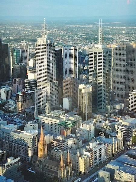 Melbourne city's Skyline and suburban streetscapes shaped by architectural styles of the Victorian period, neo-Gothic, Italianate and Classical. Melbourne, Australia.  Visited in 2003.