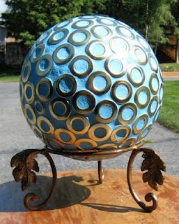 Mosaic gazing (bowling) ball using the grommets from upholstery fabric samples