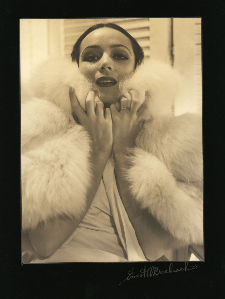 Collection of (4) oversize exhibition portraits of Dolores del Rio, Fred Astaire & Ginger Rogers and one other, by Ernest A. Bachrach. Silver bromide matte borderless double-weight prints (4) by Ernest A. Bachrach, ranging in size from 9 x 12 in. to 13 3/4 x 16 3/4 in., three of which are custom-mounted to 15 x 20 in. photographer-signed presentation mats, and from Bachrach's private collection. Includes: Dolores del Rio (2, dated 1931 and 1933); Fred Astaire and Ginger Rogers.