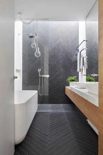 Mark St, Fitzroy North Ensuite Bathroom, chevron tile pattern, timber joinery, marble benchtop, Venetian plaster walls, skylight over open shower, free standing bath, pendant lights