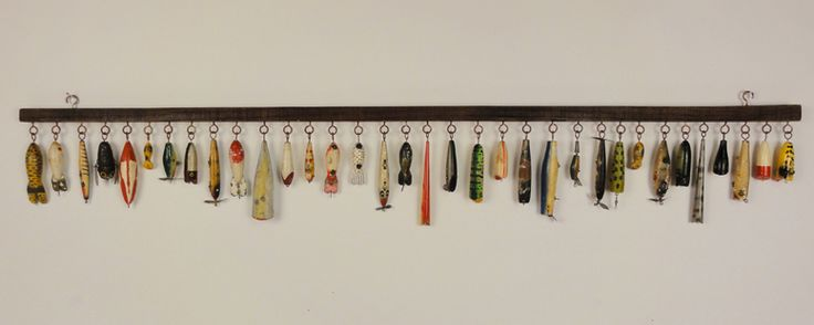 Display your vintage fish decoys or lures with a long slat and eye screws (that's what they're called, right?).