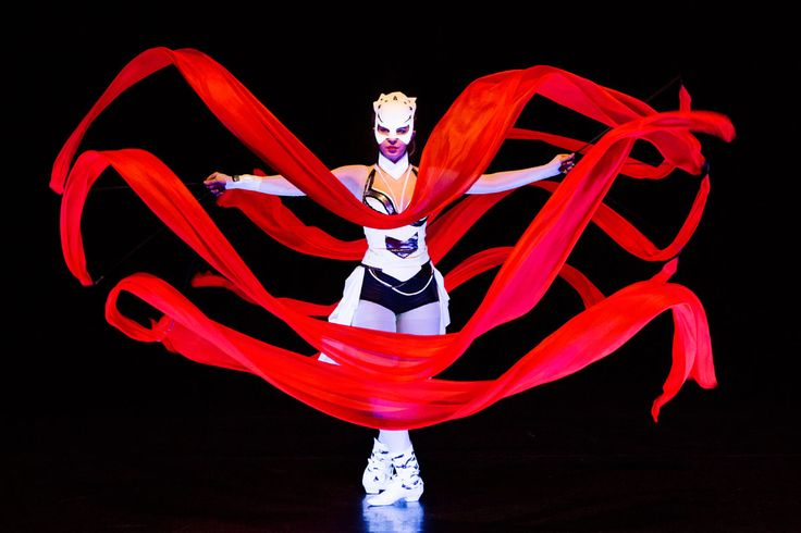 Dancer with red ribbon in UV light. Anta Agni - Crystal Light Show. http://antaagni.com/crystal-light-show/