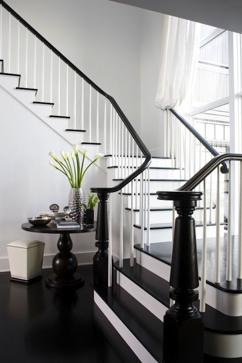 Entrances/foyers   Gray Walls Chocolate Brown Pedestal Table Glossy Black  Staircase Railing Chocolate Brown
