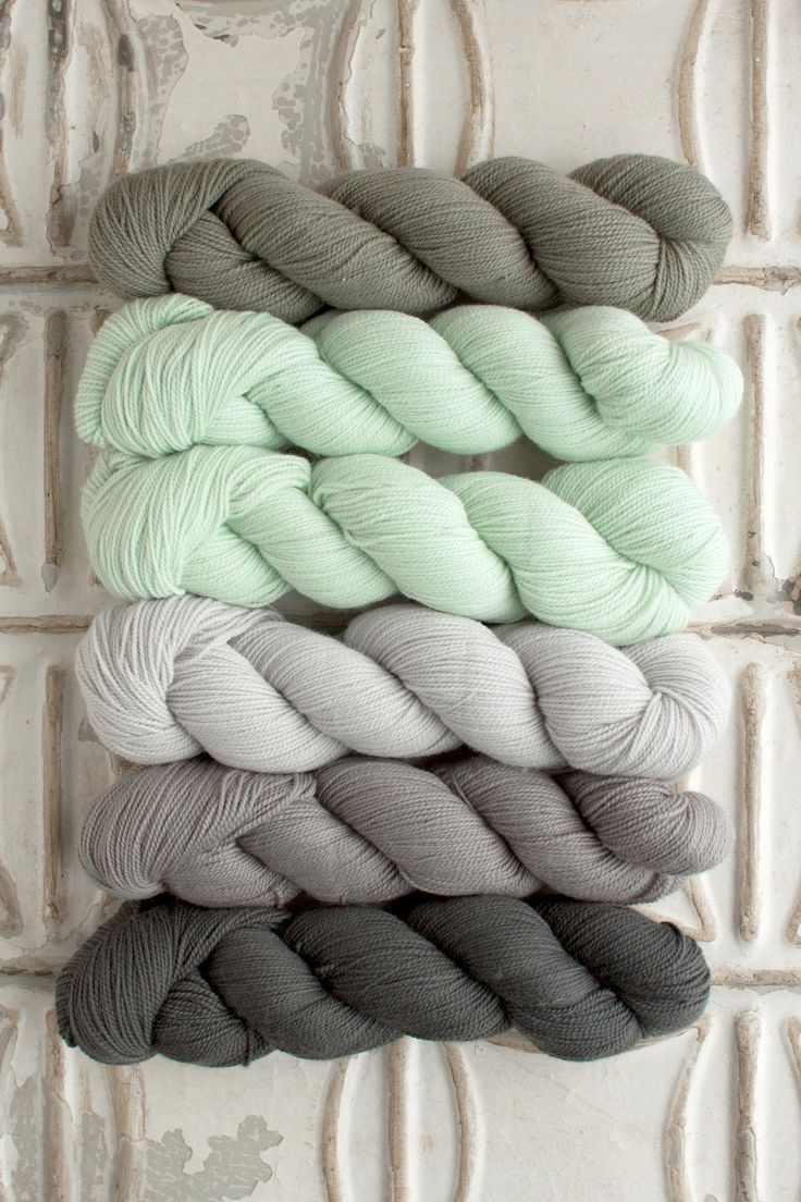 The Yarn for Andorra Wrap kit includes 6 skeins of O-Wash Fingering- 1 skein each of Colors A, C, D, and E, and 2 skeins of Color B. Get more info about O-Wash Fingering, or choose your own unique col
