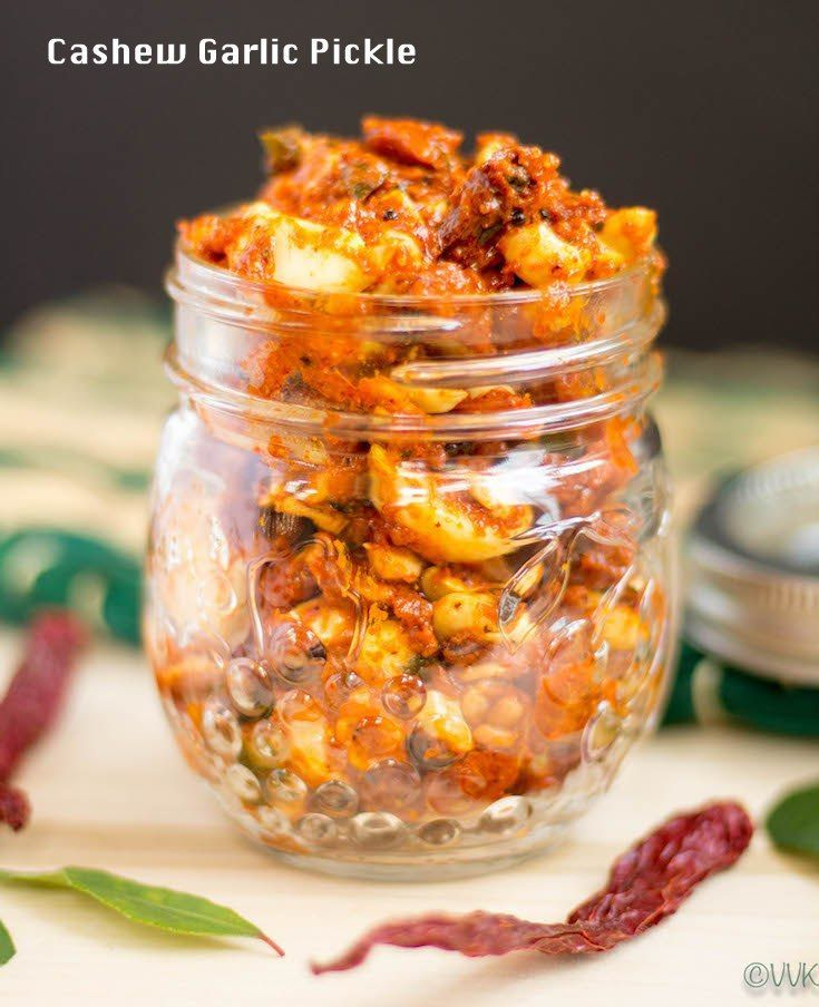 An instant spicy and tangy pickle prepared with raw garlic and cashews. A perfect spicy pickle for dal rice and yogurt rice. #pickle #garlic #andhrafood #indianrecipes #vegetarian