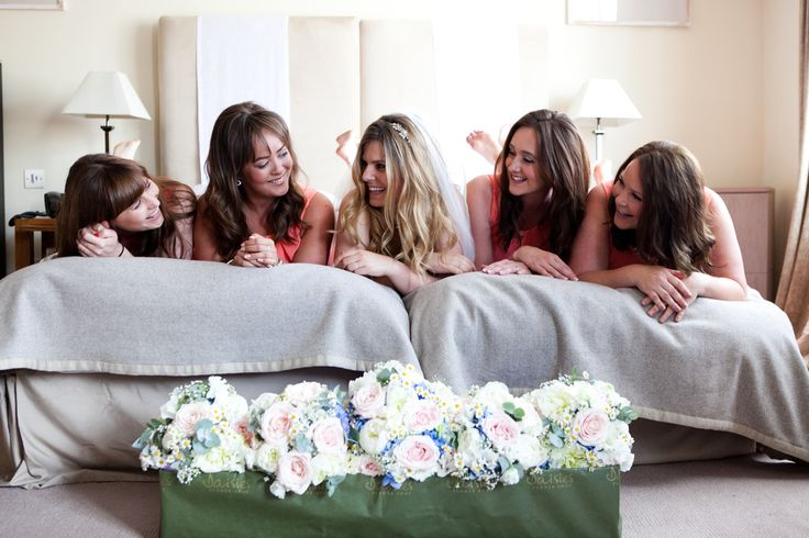 Wedding photography - Fun photo of the bride with her bridesmaids before the wedding, getting ready.
