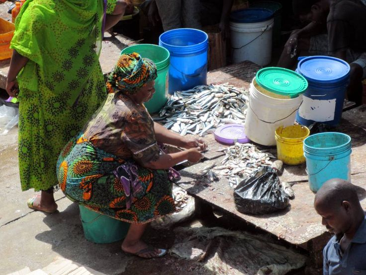 Cleaning fish at the Mzizima Fish Market in Dar es Salaam, Tanzania.