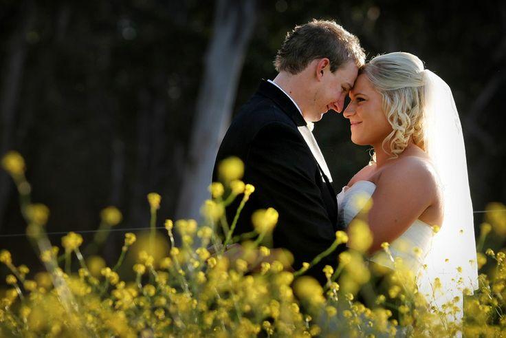 Bride & Groom + yellow wildflowers