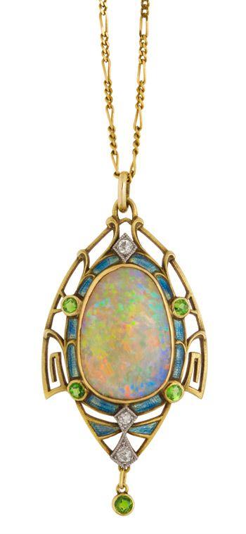Art nouveau opal pendant framed in gold set with diamonds, enamel and demantoid garnets