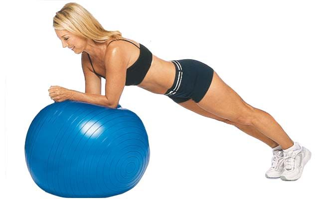 Use An Exercise Ball And Bands To Get Flatter Abs, Slimmer Legs, And A Firmer Butt