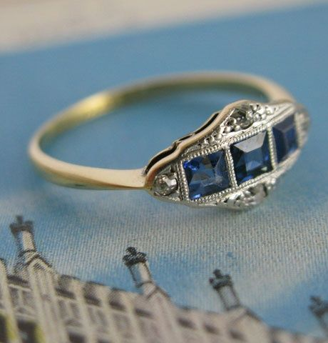 Beautiful sapphire signet ring. Not a design I'd typically love, but very pretty all the same. I love the details.