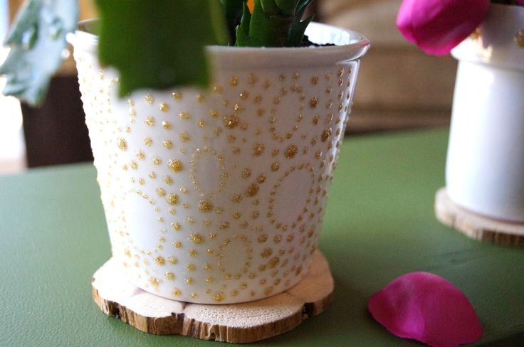 Puffy paint works well on these terra cotta pots too! It adds texture and helps you make printing and designing a whole new look so much easier. {found on Don't Disturb}