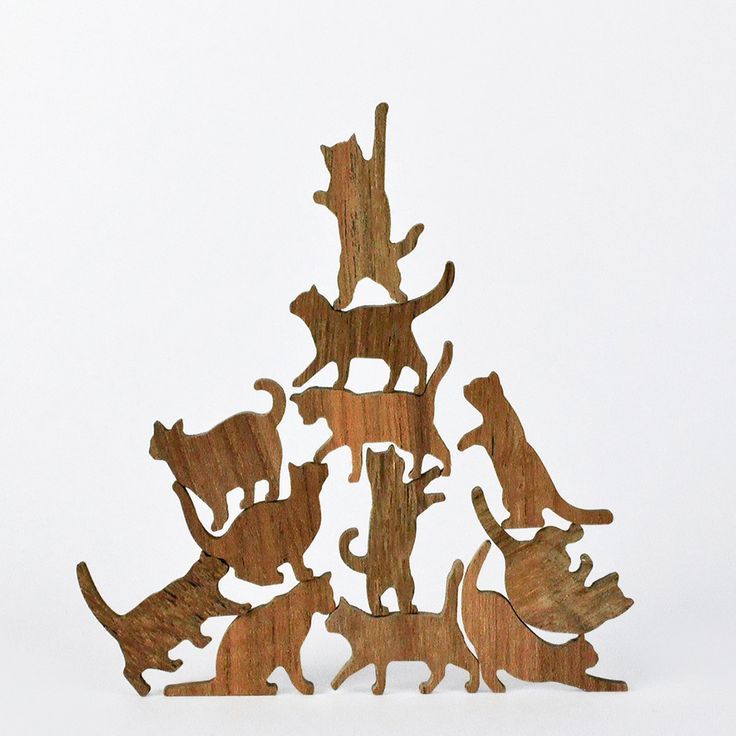 Wooden Cat Stacking Game ~ Our feline friends aren't usually known for their teamwork, but in this new reverse Jenga-like game from Comma Design Studio, cats work together to build a careening column of kitties. $19.99
