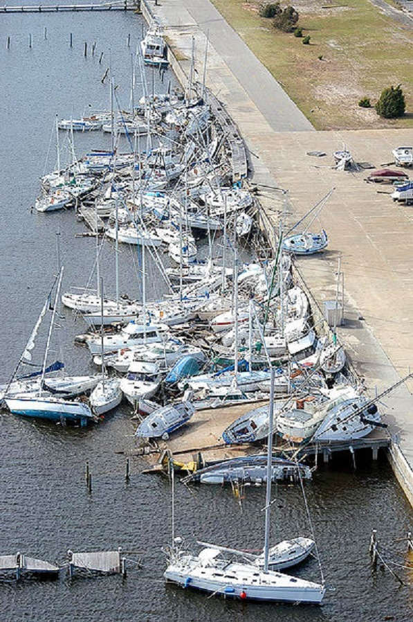 Naval Air Station Pensacola, Fla. (Sept. 22, 2004) - Hurricane Ivan sank and stacked numerous boats at Bayou Grande Marina on board Naval Air Station Pensacola. Navy officials reported that nearly 90 percent of the buildings on the base suffered significant damage. Ivan made landfall at Gulf Shores, Ala., at approximately 3:15 a.m. EST Sept. 16, with winds of 130 MPH.