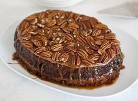 Chocolate cake baked in the slow cooker with a layer of gooey caramel in the middle. Oh and frosting and more caramel and pecans on top. YES. 8 to 10 servings