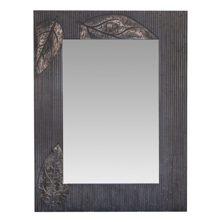 The leaf patterned mirror is a lovely original adornment for your living rooms decor it features an aged bronze finish with a floral leaf design