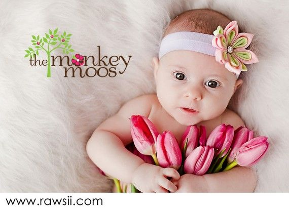 I love the idea of her holding flowers!  Next photo session idea!