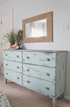 Beach themed bedroom. Aqua painted unfinished dresser from Ikea. Distressed finish, paired with custom yellow knobs. Theraggedwren.blogspot.com