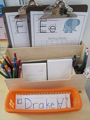 Writing centre. Class names laminated, love the clipboard idea! Add theme printing activities/letter of the week extra practice!
