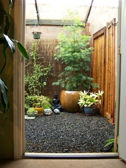 Small area too small/wet/shady for grass? Rocks! And pots. An effective alternative.