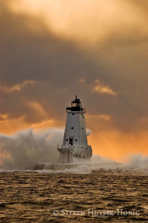 A strong wind and high seas had been battering the Lake Michigan coast all day long