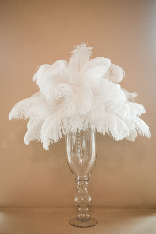 Bouquet of white feathers in a clear slender vase photo