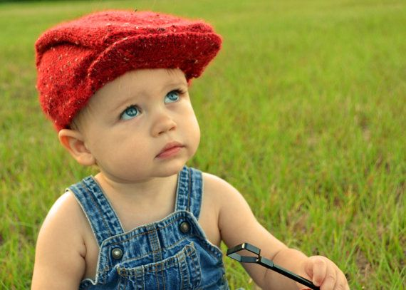 Hand knit newsboy hat in red tweed for toddlers.